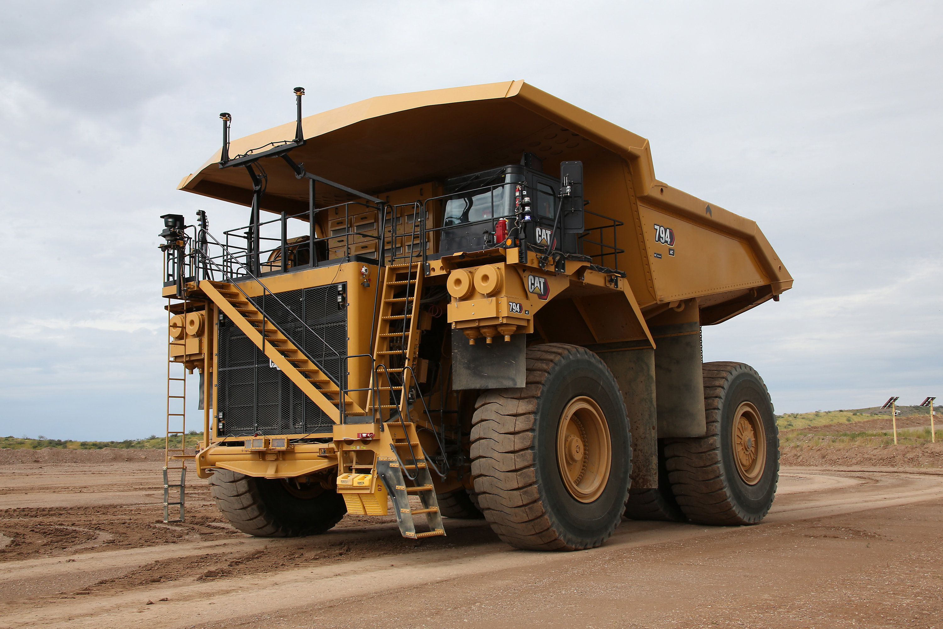 The Cat 794 AC Mining Truck is equipped with Cat® MineStar™ Command for hauling, an autonomous hauling solution.