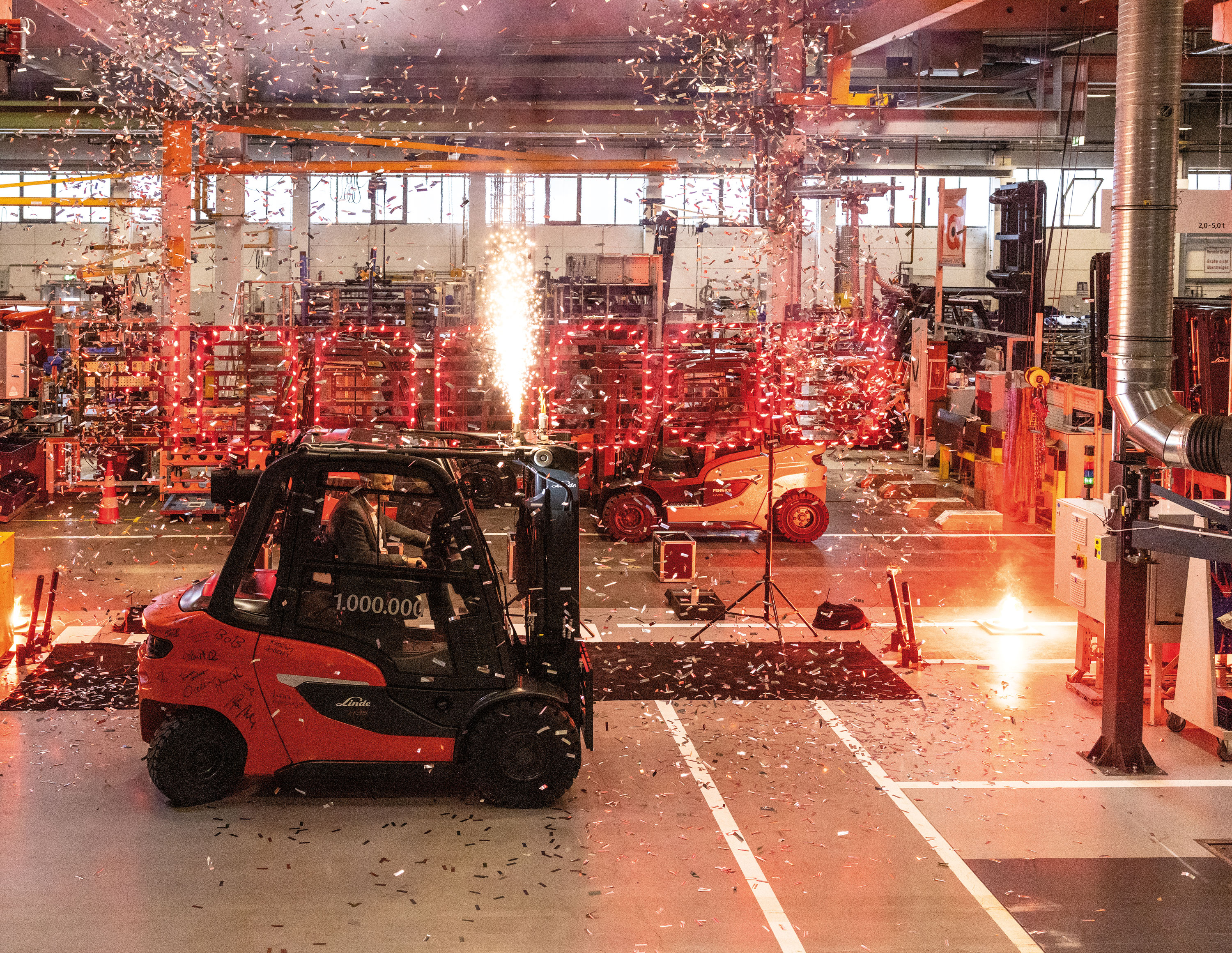 A dazzling indoor fireworks display marked the occasion as the one-millionth counterbalance truck produced at Linde Material Handling's Aschaffenburg plant left the assembly line. Photo: Linde Material Handling GmbH, Aschaffenburg