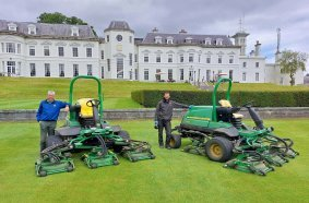 The K Club Resort Superintendent Gerry Byrne (left) with his Deputy Jamie Robson and the new John Deere 9009A TerrainCut rotary rough mowers.