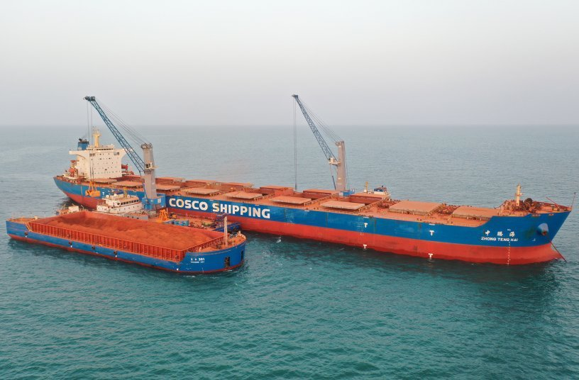 Cosco's first two Konecranes Gottwald cranes on barge handling bauxite off the west coast of Africa