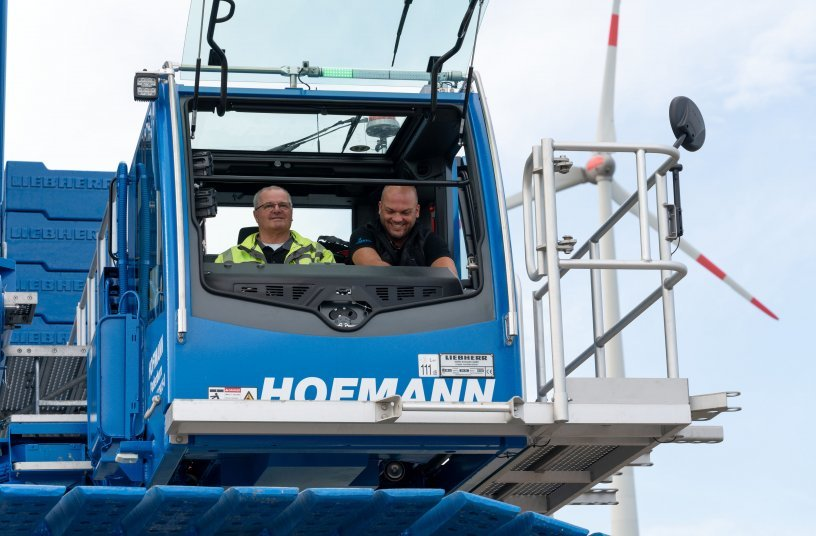 Good mood: Christian Bergmaier (left) and Stephan Dickel in the spacious cabin of their new Liebherr crawler crane. <br> Image source: Liebherr-Werk Ehingen GmbH